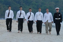 Groom and groomsmen on the beach