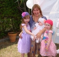 naming ceremony photo with celebrant and three girls that she named