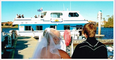 bride walking down the aisle to a house boat for her wedding