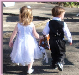 flowergirl and pageboy leading the wedding procession