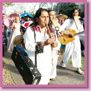 procession of bride, groom and guests with Andes band