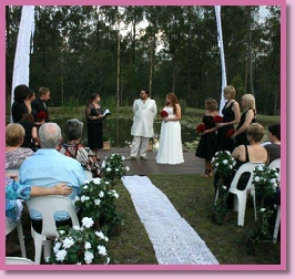 wedding ceremony by Marlee Bruinsma at a couple's home by their lake